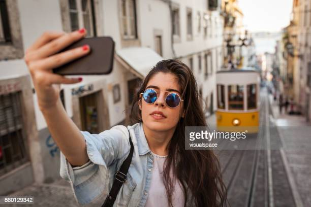 selfie with the old tram in lisbon - phone cover stock pictures, royalty-free photos & images