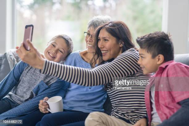 a selfie with three generations! - asian granny pics stock photos and pictures