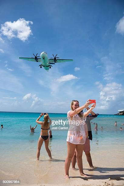 Selfies and aircraft at Maho Beach, St. Maarten