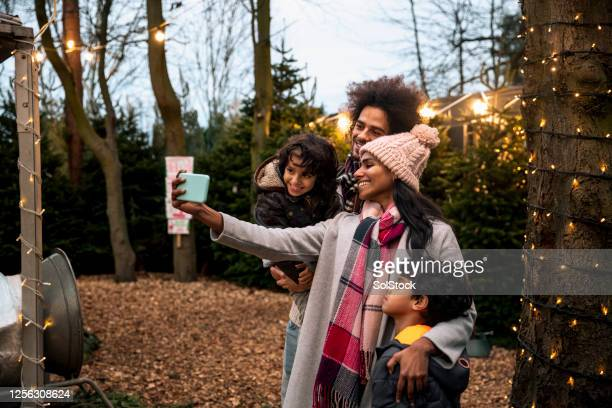 selfies at dusk - public celebratory event stock pictures, royalty-free photos & images