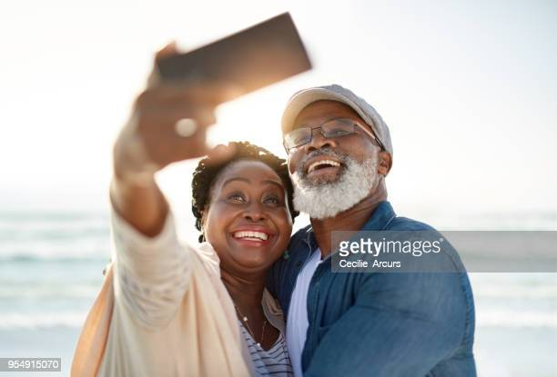 selfies by the beautiful sea - beautiful wife pics stock pictures, royalty-free photos & images