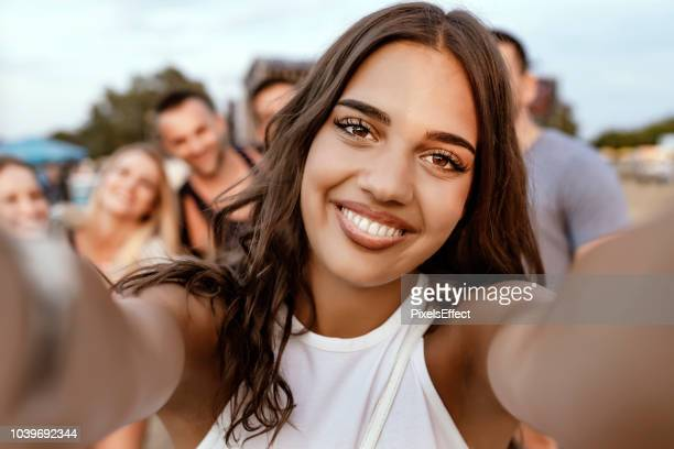 selfies of celebration - festival goer stock pictures, royalty-free photos & images