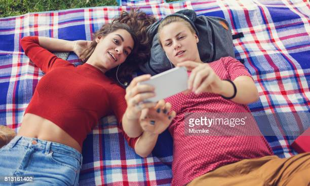 selfies on a picnic blanket - lesbian date stock pictures, royalty-free photos & images