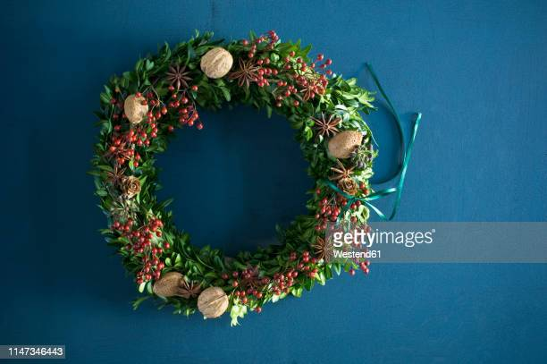 selfmade advent wreath, box twigs, rosehip, star anise, walnuts and almonds - wreath stock pictures, royalty-free photos & images
