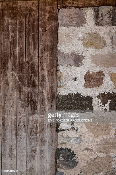 selfmade stone and wooden wall - ems forster productions stock pictures, royalty-free photos & images