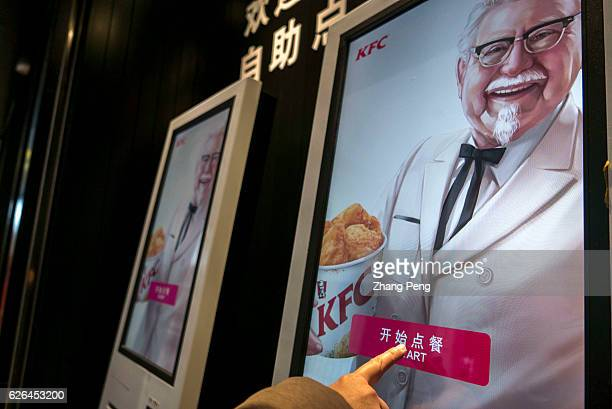 Selfordering machine outside a KFC restaurant As the largest restaurant chain in China with more than 7000 outlets KFC makes new strategy including...