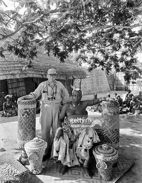 Selfportrait of American photographer Arnold Newman as he poses with the King of the Bakuba Kingdom Mushenge Belgian Congo fall 1958