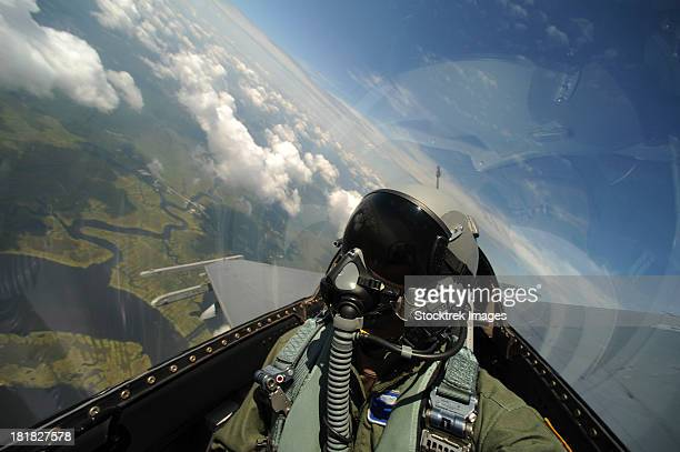 Self-portrait of an aerial combat photographer during takeoff.