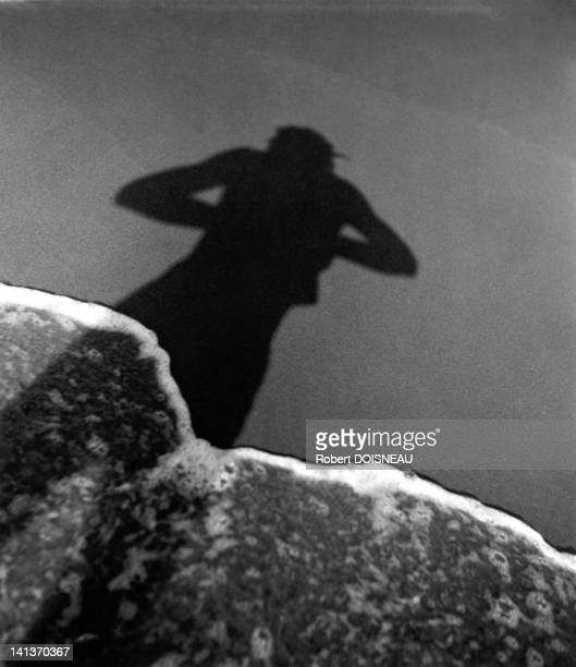 Selfportrait of Robert Doisneau on the beach circa 1939 in France