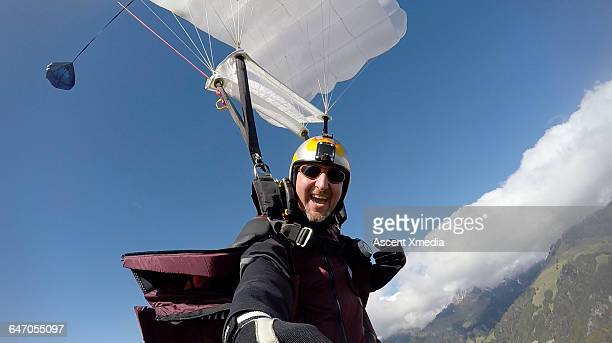 Self-portrait of wingsuit flyer in mid-air flight