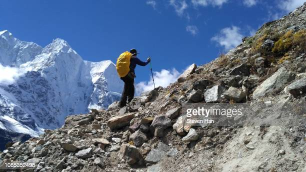 self-portrait when climbing mountains towards everest base camp in tibet, china - toughness stock pictures, royalty-free photos & images