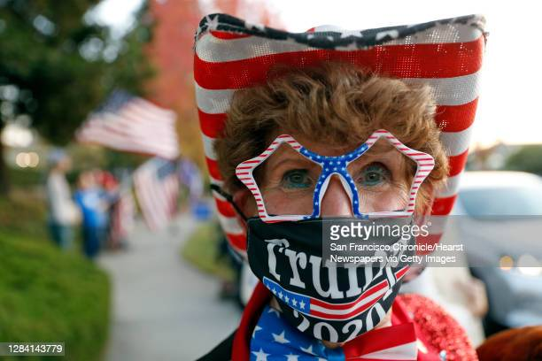 """Self-proclaimed """"Ambassador of Fun,"""" Mary Lynn Pelican of Fremont joins fellow supporters of US president Donald Trump taking part in a """"Trump Town..."""