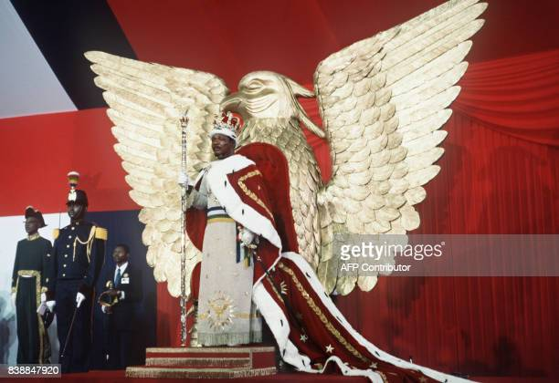 Selfproclaimed emperor of Centrafrican empire JeanBedel Bokassa stands 04 December 1977 on his throne after crowning himself in Bangui following...