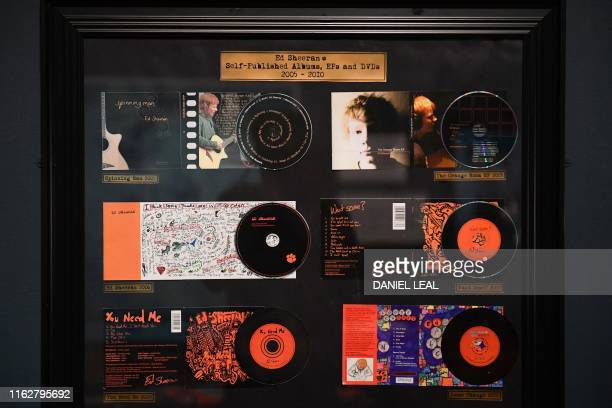 Selfpublished albums by British musician Ed Sheeran are pictured during a press preview of the exhibition 'Ed Sheeran Made in Suffolk' in Ipswich...