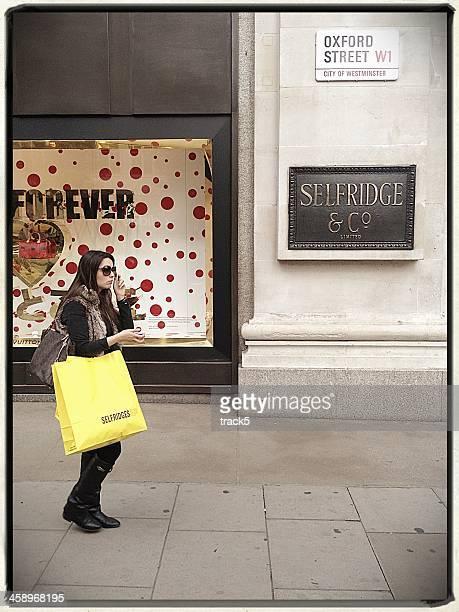 selfridge shopper, oxford street, london - selfridges stock photos and pictures