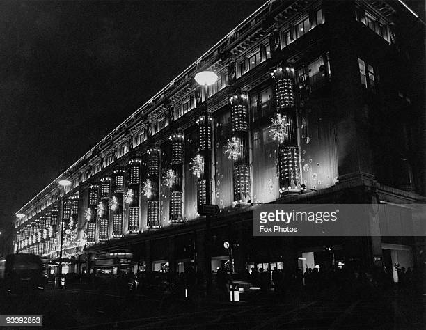Selfridges department store in Oxford Street London decorated with Christmas lights 1968