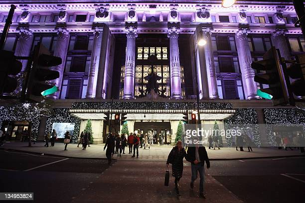 Selfridges department store is illuminated on Oxford Street with less than three weeks before Christmas Day on December 5, 2011 in London, England....