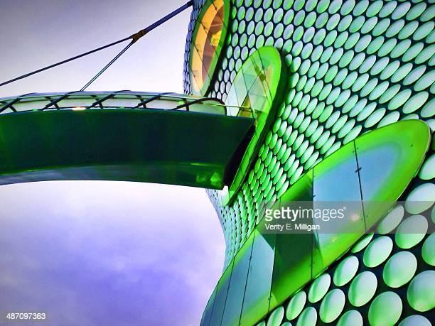 selfridges in birmingham lit up green - birmingham england stock pictures, royalty-free photos & images