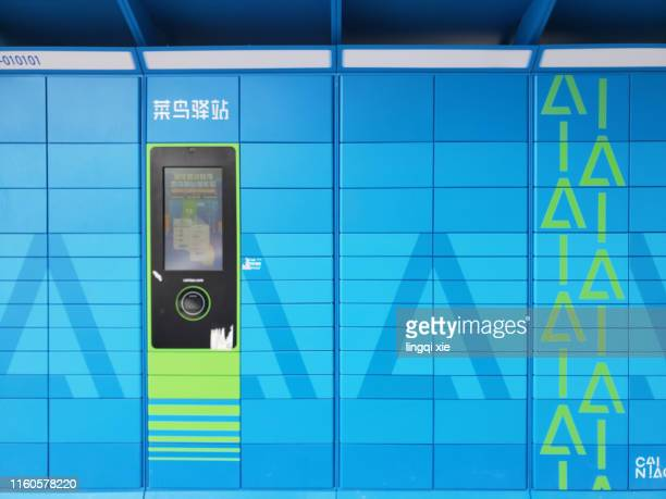 self-service express pick-up point in hangzhou, china - design occupation stock pictures, royalty-free photos & images