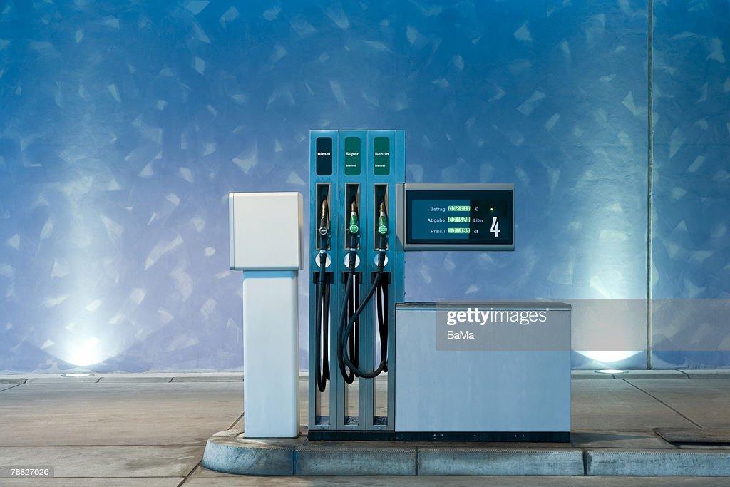 Self-service fuel pump at gas station at night, long exposure, tripod : Stock Photo
