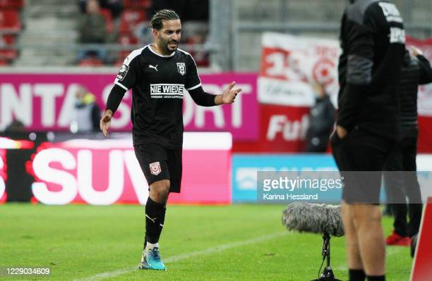 Selim Guenduez of Halle leaves the pitch after 2 yellow cards and red card during the 3.Liga match between Hallescher FC and FSV Zwickau at Erdgas...