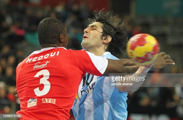 Selim Hedoui of Tunisia blocks Federico Matias Vieyra of Argentina during the men's Handball World Championships main round match Argentina vs...