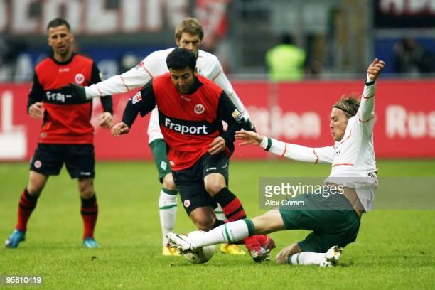 Selim Teber of Frankfurt is challenged by Clemens Fritz of Bremen during the Bundesliga match between Eintracht Frankfurt and Werder Bremen at the...