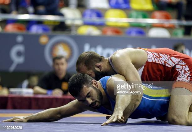 Selim Yasar of Turkey competes with Ahmed Magamaev of Bulgaria in Men's freestyle 86 kilograms match at the 48th International Yasar Dogu Freestyle...