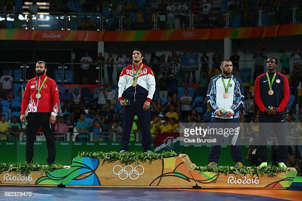 Selim Yasar of Turkey gold medalist Abdulrashid Sadulaev of Russia and bronze medalists Sharif Sharifov of Azerbaijan and J'den Michael Tbory Cox of...
