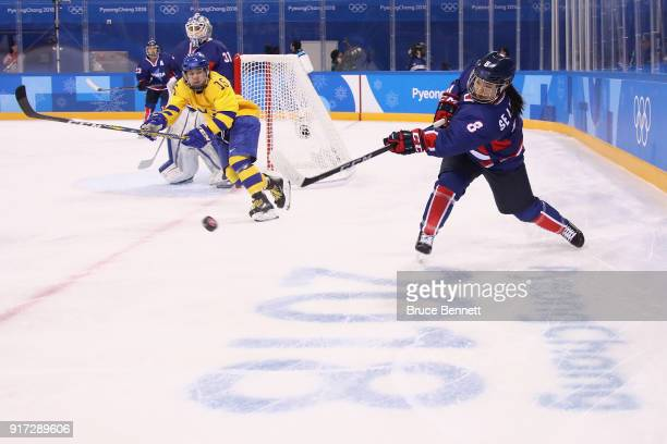 Selin Kim of Korea passes the puck in the first period against Sweden during the Women's Ice Hockey Preliminary Round Group B game on day three of...
