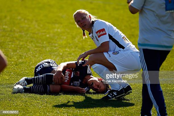 Selin Kuralay of Melbourne Victory is consoled by Kim Carroll of Perth after sustaining an injury during the round one WLeague match between the...