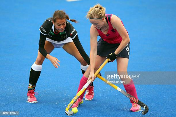 Selin Oruz of Germany battles with Fiona Bruce of Scotland during match 7 between Scotland and Germany on day four of the Unibet EuroHockey...