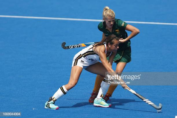 Selin Oruz of Germany battles with Tarryn Glasby of SA during the Pool C game between Germany and South Africa of the FIH Womens Hockey World Cup at...