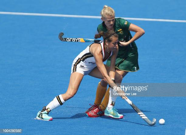 Selin Oruz of Germany battles with Tarryn Glasby of South Africa during the Pool C game between Germany and South Africa of the FIH Womens Hockey...