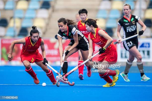 Selin Oruz of Germany challenges for the ball with Wen Dan and Jinrong Zhang of China during the Women's FIH Field Hockey Pro League match between...