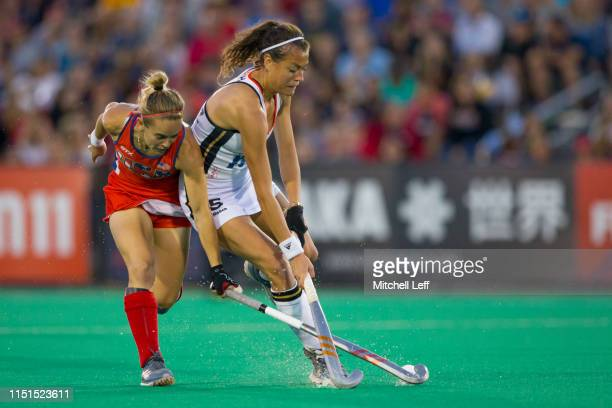 Selin Oruz of Germany competes for the ball against Alyssa Manley of the United States during the Women's FIH Field Hockey Pro League match between...