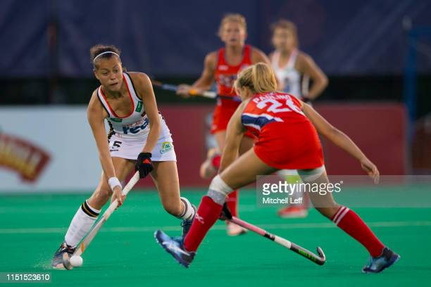Selin Oruz of Germany controls the ball against Margaux Paolino of the United States during the Women's FIH Field Hockey Pro League match between the...
