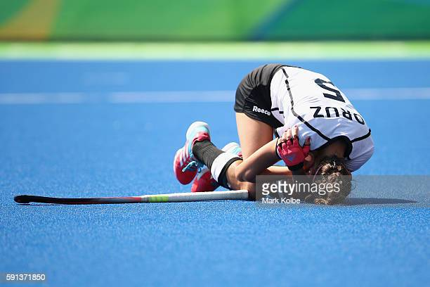 Selin Oruz of Germany holds her shoulder as she lies on the ground after being hit by the ball during the womens semifinal match between the...