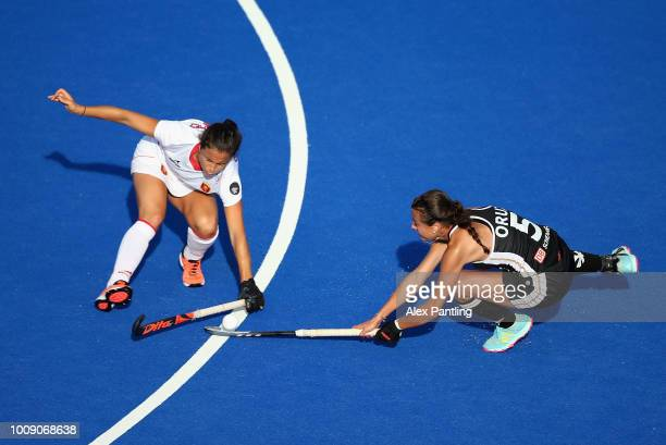 Selin Oruz of Germany is tackled by Rocia Gutierrez of Spain during the quarter final game between Germany and Spain of the FIH Womens Hockey World...