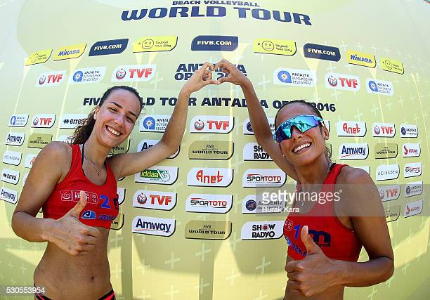 Selin Yurtsever and Burcu Atasoy of Turkey gestures during the 2nd day of the FIVB Antalya Open beach volley tournament May 11 in the Mediterranean...