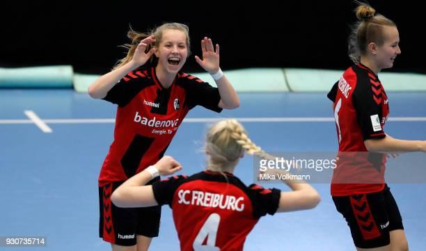 Selina Fockers of Freiburg celebrates scoring a goal with Talke Broeker during the DFBFutsalCup half final match between 1FC Koeln vs SV Adler Berlin...