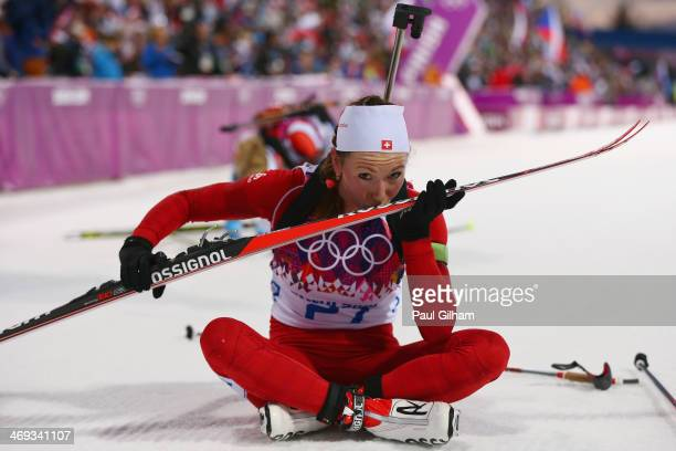 Selina Gasparin of Switzerland kisses her ski at the finish line in the Women's 15 km Individual during day seven of the Sochi 2014 Winter Olympics...