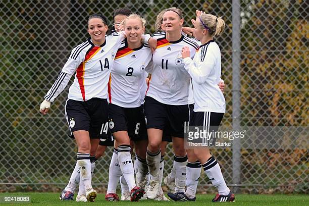 Selina Wagner Kristina Gessat Alexandra Popp and Laura Brosius of Germany celebrate their teams second goal during the Women's International friendly...