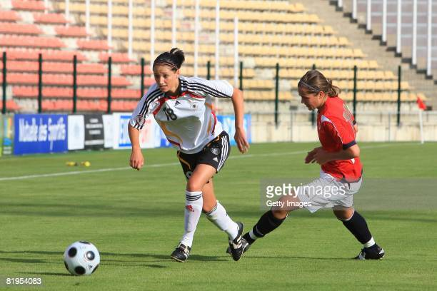 Selina Wagner of Germany and Elise Ida Enget of Norway fight for the ball during the Women's U19 European Championship match between Germany and...