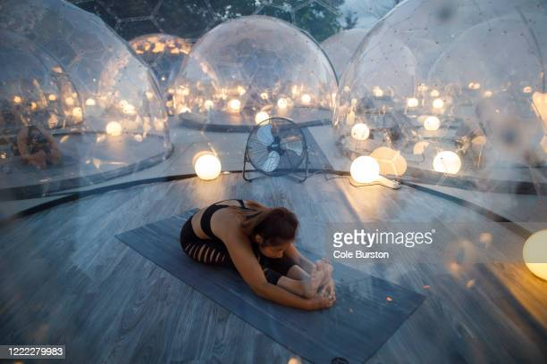 Seline Taye participates in an outdoor yoga class at Hotel X, inside domes to comply with social distancing measures to control the spread of...