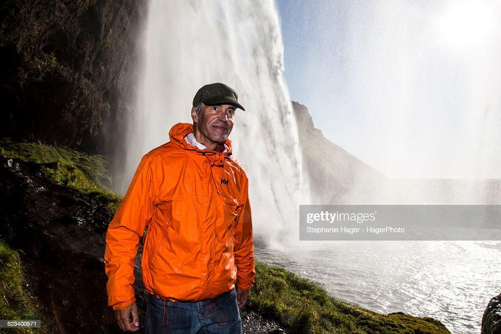 Seljalandsfoss and man walking : Stock Photo