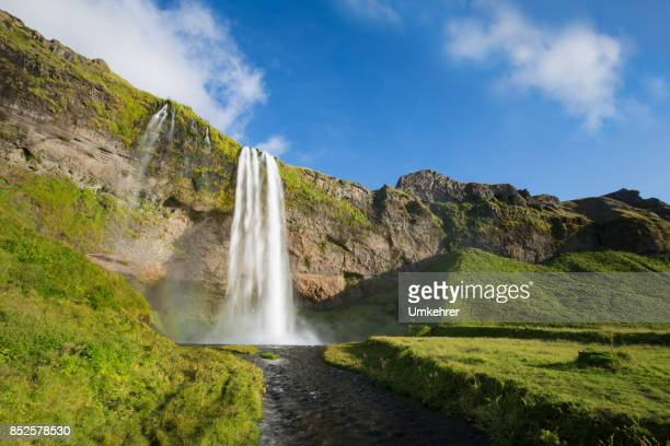 seljalandsfoss in iceland - behind waterfall stock pictures, royalty-free photos & images