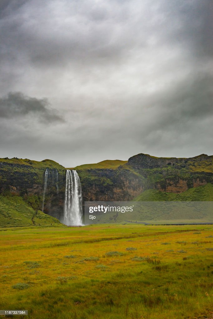 Seljalandsfoss waterfall in Iceland with a dark sky above : Stock Photo