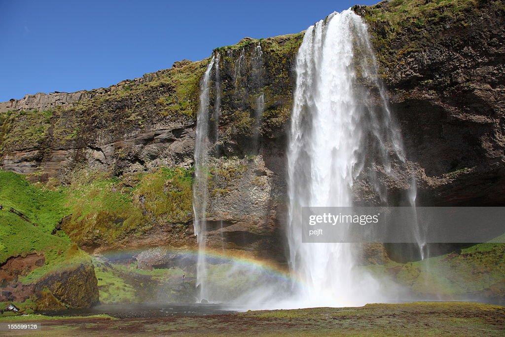 Wasserfall Seljalandsfoss mit Regenbogen, Island : Stock-Foto
