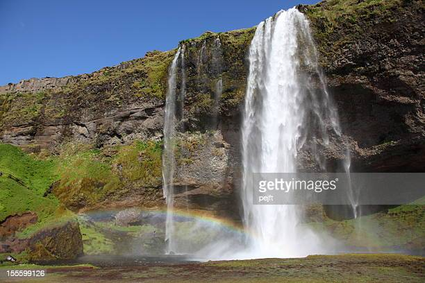 seljalandsfoss waterfall with rainbow, iceland - pejft stock pictures, royalty-free photos & images
